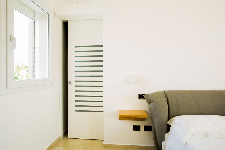 Porta legno scorrevole pantografata